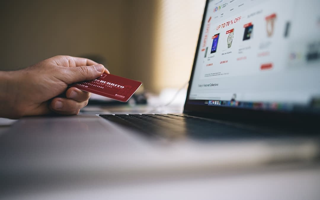computer with ecommerce site and buyer using credit card indicating nationwide presence